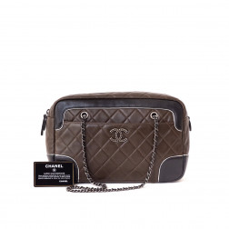 Bolso shopping en piel acolchada bicolor marrón y negra.